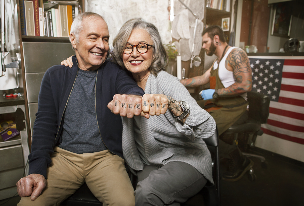 "Portrait of senior couple with""ture love"" knuckle tattoos."