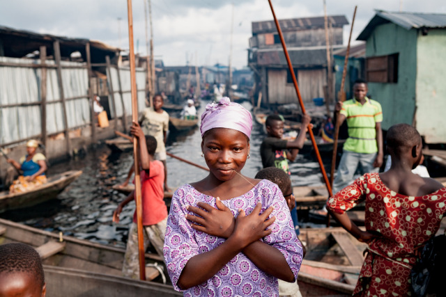 A girl poses in a slum built on stilts in the Lagos Lagoon called Makoko. gallery