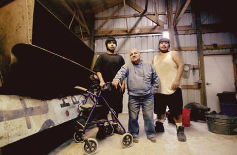 Subject: Dale and his grandsons in their processing plant gallery